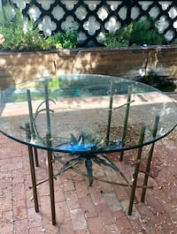 round black metal framed glass top patio table Scottsdale, 85251