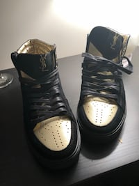 Pair of black-and-gold Yves Saint Laurent high-top sneaker