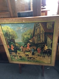 people riding on horse near brown house painting