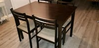 brown wood dining table with 4 chairs 538 km