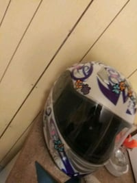 white and purple full-face helmet 891 mi