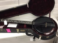 black and brown acoustic guitar in case Chicago, 60647