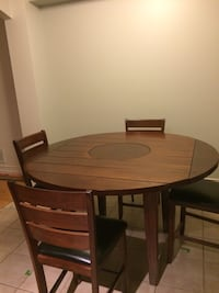 Brown wooden counter height dining table set Ottawa, K1Z 6V6