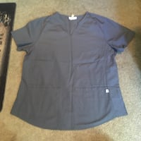 Scrub top size small, fits larger  3489 km