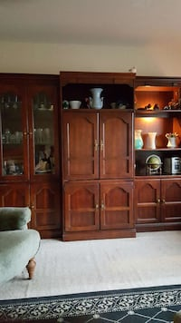 brown wooden cabinet with shelves