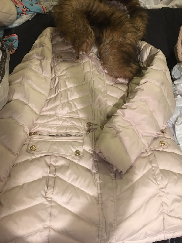 white and brown parka jacket