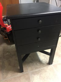 Black wooden side table with games