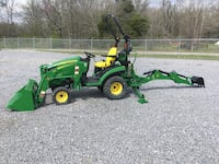 Green and yellow John Deere tractor with loader and back hoe Piedmont, 36272