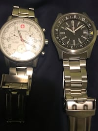 two round silver analog watches with link bracelets 43 km