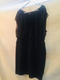 Women's black sleeveless dress (golden glitter adorns bodice, skirt has a slight ruffle to it) Centennial, 80122