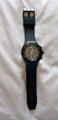 round black chronograph watch with black rubber st