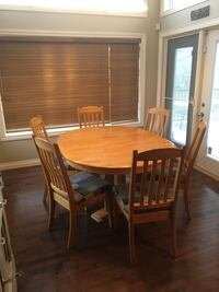 Solid Oak Dining Table with 6 newly reupholstered Chairs! High River