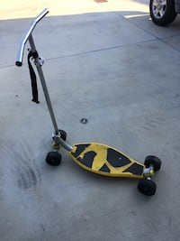 Black and yellow kick scooter