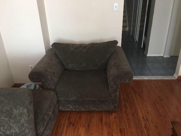Brown fabric sofa chair with ottoman