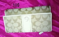 white and gray Coach monogram wallet