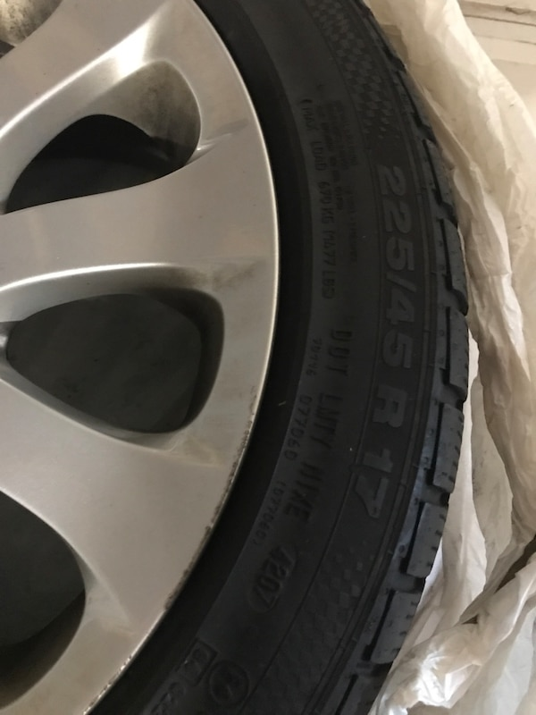 Gray bmw multi-spoke wheel with tire 12c1ba73-d018-4cb0-a989-0530e53615e2