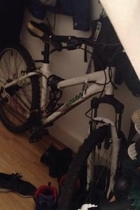 White and black full suspension mountain bike London, N11