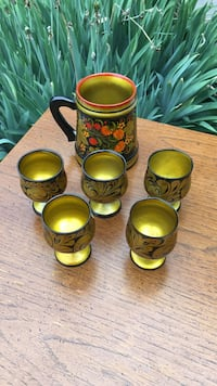 four brown ceramic candle holders Frederick, 21702