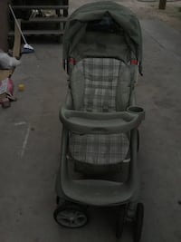 Gray and white graco stroller