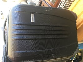 Hard suitcase with wheels. Size 20 x 15 x 8