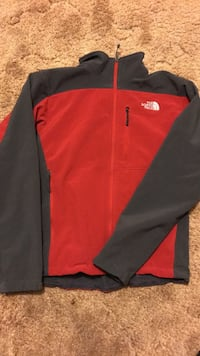 Red north face jacket 1963 km