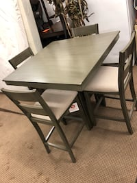 Elegant countertop height dining room table with 4 chairs