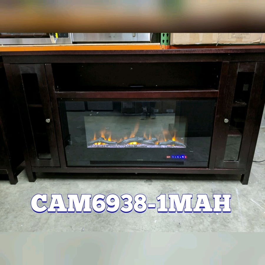 Large electric heater fireplace unit. T.V. stand