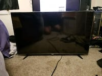 black flat screen TV with remote Temecula, 92591