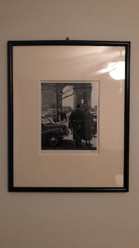 Black wooden frame with picture of Arc de Triumph Washington, 20037