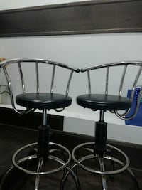 two round black leather seat bar stools with stainless steel bases Vancouver, V5X 1N3