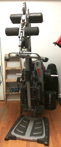 Used bowflex revolution home gym with all attachments extra
