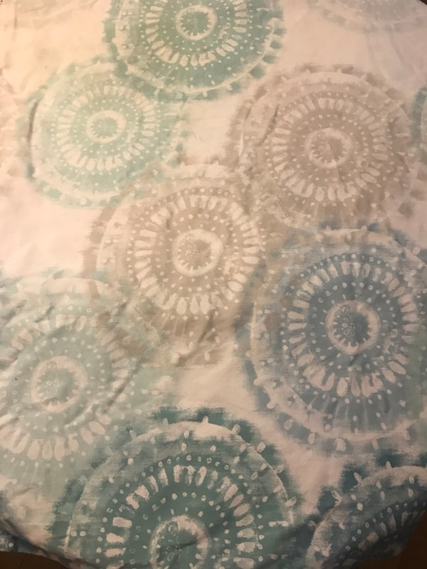 Shower curtain. Bought it but never used it. Light blue design, fades to white at top. All linen and no plastic.