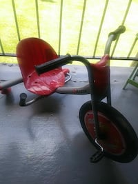 toddler's red and grey pedal trike