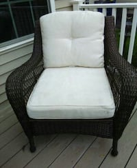 brown wooden framed white padded armchair 286 mi