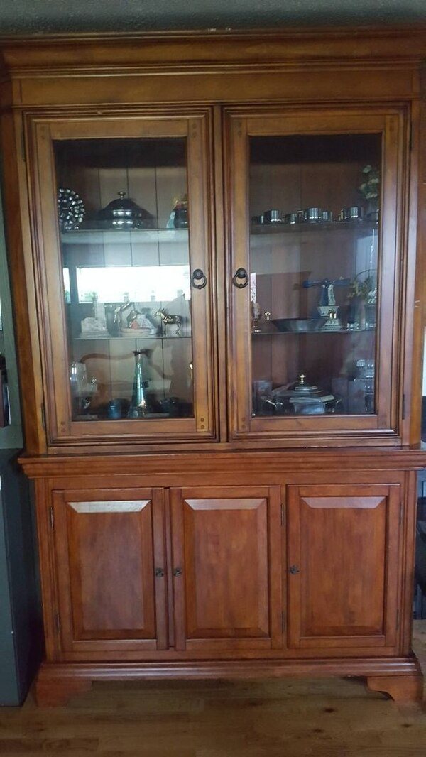 brown wood-framed glass display cabinet