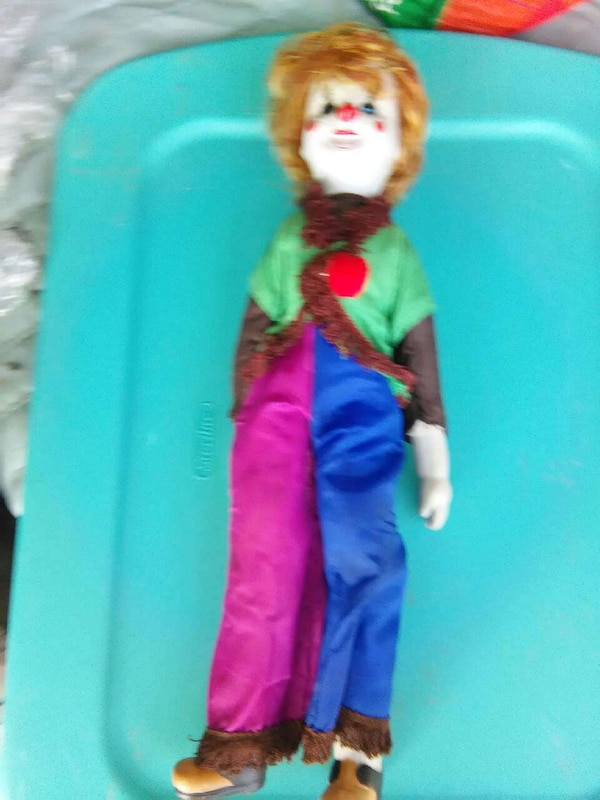 clown in green, pink and blue jumpsuit