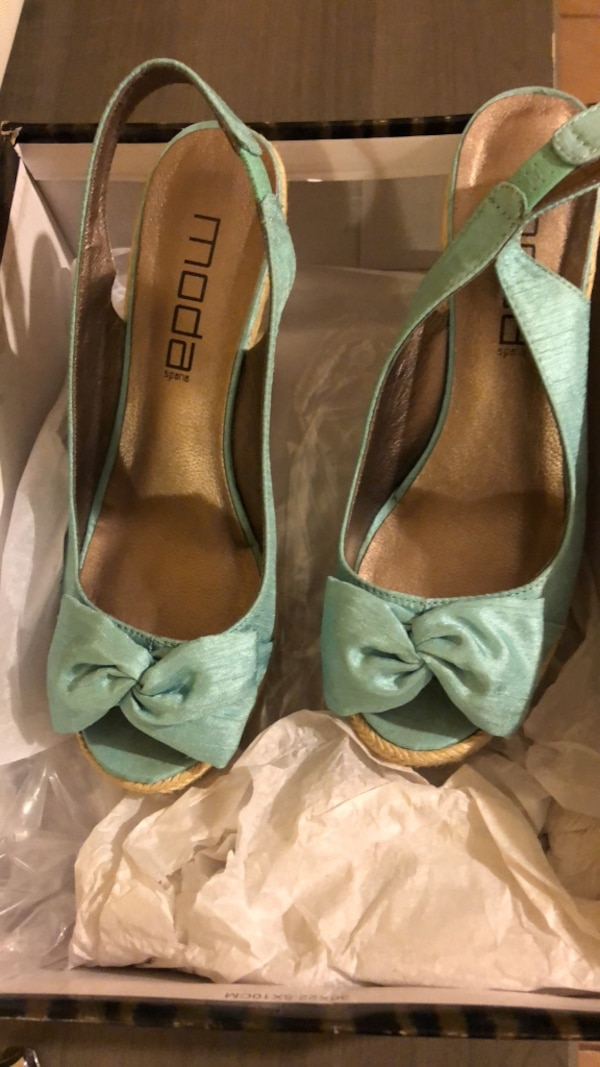 pair of green leather peep-toe heels