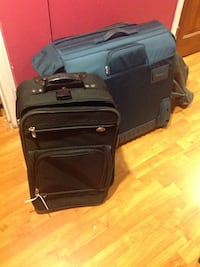 two blue-and-black luggage