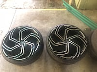 two silver car wheels and tires 2394 mi