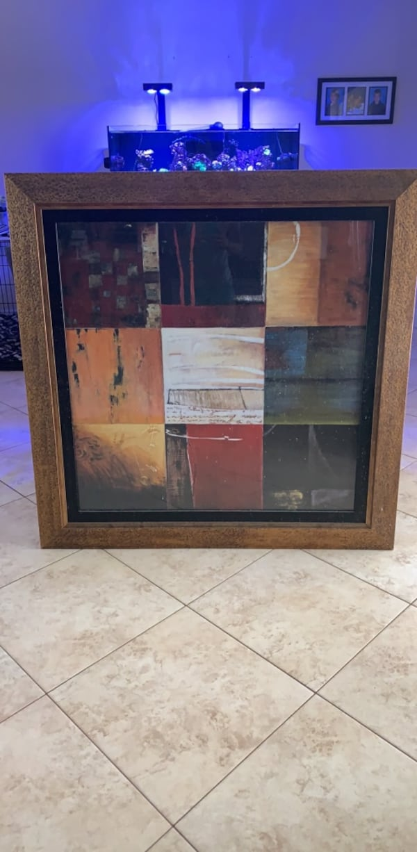 Gold frame and glass panel 1612b3db-4aac-4084-a40a-ed7e43db5b98