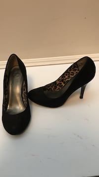 pair of black leopard-print heeled shoes