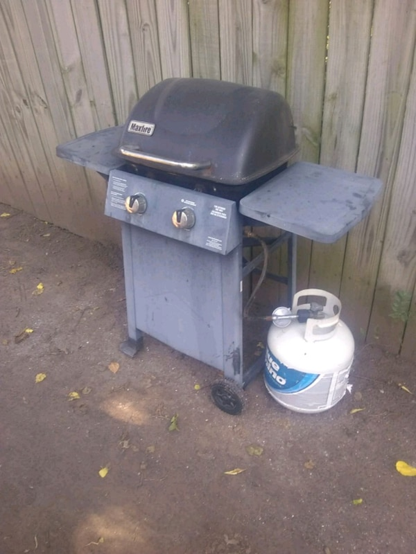 Propane grill with bottle of propane