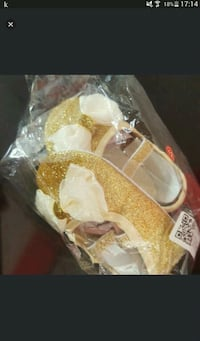 pair of yellow-and-white shoes in box Toronto, M9V 4C4