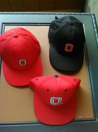 three red and black fitted caps