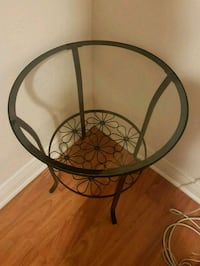 round black metal framed glass-top table Toronto, M3J 1X4