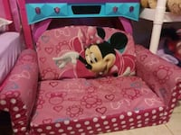 pink and white Minnie Mouse print textile
