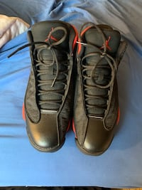 pair of black Air Jordan basketball shoes 30 km