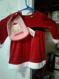 girl's red and white Christmas-themed dress and red and white striped bib Lodi, 95242