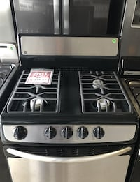 --*Stainless Steel 24 inch Gas Stove used GE  Farmingdale