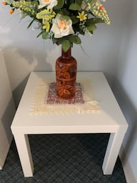 Brown wooden table with two white ceramic vases like new Pitt Meadows, V3Y 2H8